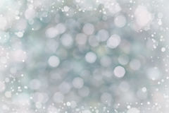 Abstract bokeh background for your design, blurred lights with snow effect Royalty Free Stock Image