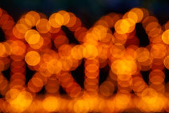 Abstract bokeh of chain of lights Royalty Free Stock Photos