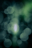 Abstract bokeh festive background with defocused lights.  Stock Photo