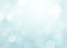 Abstract bokeh hexagonal shape on blue and white background Royalty Free Stock Photos