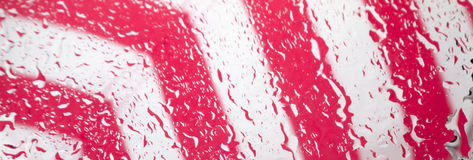 Abstract bokeh light background. Bokeh backgrounds water splash on pink and white stripes Stock Photos
