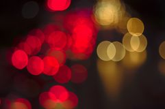 Abstract bokeh light fades neon, on black background and lighting illuminated from street,concept of beauty brightness of shine. Defocused,banner panoramic for stock photo