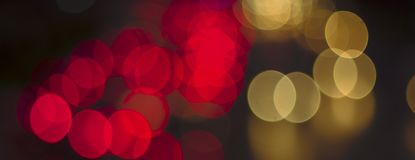 Abstract bokeh light fades neon, on black background and lighting illuminated from street,concept of beauty brightness of shine. Defocused,banner panoramic for royalty free stock image