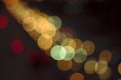 Abstract bokeh light fades neon, on black background and lighting illuminated from street,concept of beauty brightness of shine. Defocused royalty free stock photos