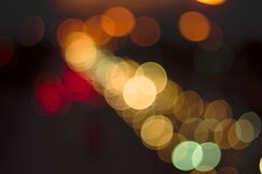 Abstract bokeh light fades neon, on black background and lighting illuminated from street,concept of beauty brightness of shine. Defocused royalty free stock photo