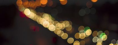 Abstract bokeh light fades neon, on black background and lighting illuminated from street,concept of beauty brightness of shine. Defocused,banner panoramic for royalty free stock photography