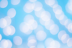 Abstract of Bokeh Lights Against a Blue Background Royalty Free Stock Image