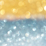 Abstract bokeh lights with gold and blue glitters Stock Photography