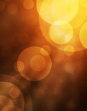 Abstract bokeh lights on golden and red background Stock Photography