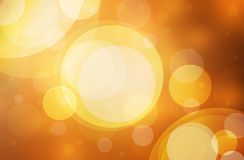 Abstract bokeh lights on golden and red background Stock Image
