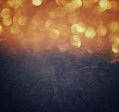 Abstract bokeh lights over blackboard textured background Royalty Free Stock Images