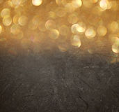 Abstract bokeh lights over blackboard textured background. Royalty Free Stock Images