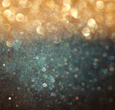 Abstract bokeh lights over blackboard textured background.