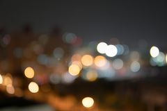 Abstract bokeh night garden in city background.Defocused city night filtered bokeh abstract background.  royalty free stock photography