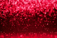 Abstract bokeh red and burgundy color circular background. Christmas light or season greeting background.Red shining lights,sparkl. Ing glittering new year royalty free stock image