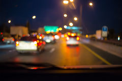 Abstract bokeh of road in car for background. Royalty Free Stock Photography