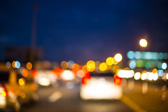 Abstract bokeh of road in car for background. Royalty Free Stock Photos
