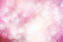Abstract bokeh and snow flakes background, pink and white. Royalty Free Stock Image