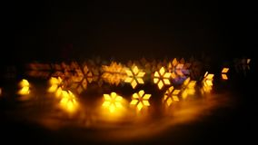 An abstract, bokeh-style video of city lights with a distant fireworks. Turning, dynamic light shapes. New Year celebration stock video