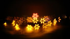 An abstract, bokeh-style video of city lights with a distant fireworks. Turning, dynamic light shapes. New Year celebration stock video footage