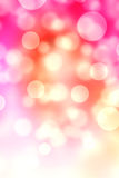 Abstract Bokeh vertical pink flare background texture. Royalty Free Stock Image