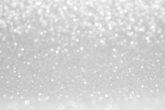 Abstract bokeh white,light grey,sliver colors de focused circular background.Night light season greeting elegance backdrop or artw