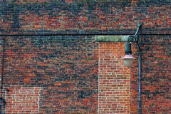 Abstract Brick wall and lamp post Stock Photography