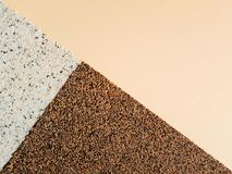 Figure, three triangles in a rectangle with pebbles, grains stock photos
