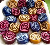 Abstract bright colors spiral kids party jelly rolls food. Unusual and very bright colourful jelly and marshmallow roll up treats for a child's party royalty free stock photos