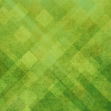 Abstract bright green background design and texture. Abstract green squares lines diamonds angled in random pattern for graphic art use in web and website