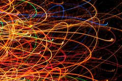 Abstract Bright Multicolored Glowing Lines and Curves on Black Background