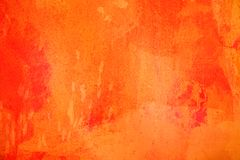 The abstract bright orange surface has a brush painted on the background for graphic design. The abstract bright orange color surface has a brush painted on the stock photos