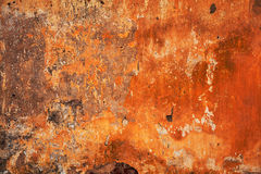 Abstract bright orange - red texture. Grunge background - empty space for the designer fantasies. Old wall Royalty Free Stock Image