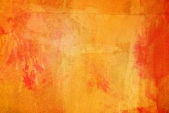 The abstract bright orange surface has a brush painted on the background for graphic design. The abstract bright orange surface has a brush texture painted on royalty free stock image