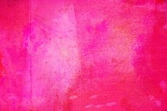 The abstract bright pink surface has a brush painted on the background for graphic design. The abstract bright pink surface has a brush texture painted on the stock photos