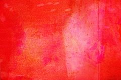 The abstract bright red surface has a brush painted on the background for graphic design. The abstract bright red color surface has a brush painted on the royalty free stock image