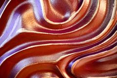 Abstract, brown, convex, three-dimensional, unique beautiful, wavy texture of a stone wall of concrete painted with paint. The background Royalty Free Stock Photo