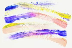 Abstract brush strokes. Close-up fragment of hand painted acrylic multicolor painting on white paper, violet, yellow and. Pink shades. Modern art background Royalty Free Stock Image