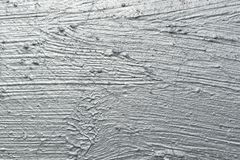 Abstract brush strokes with silver paint. On the wall Stock Photo