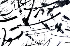 Abstract brush strokes and splashes of paint on paper. Grunge art calligraphy background.  royalty free stock images