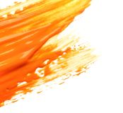 Abstract brushstroke of orange paint. Isolated on white stock photos