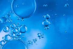 Abstract bubbles of oxygen floating towards the surface Stock Image