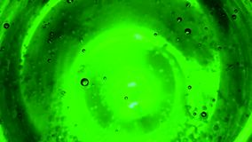 Abstract bubbles in water like in space against green lime background. Or fizzy water in glass close up stock video