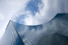 Abstract building background. Against sky and clouds stock images
