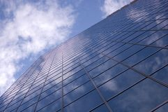 Abstract building background. Against sky and clouds Stock Photos