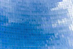 Abstract building background. / reflection of the sky on glass surface stock photography