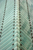 Abstract building - glass windows. Held by metal stock photo
