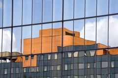 Abstract building reflection. View of modern building with another building reflecting off its windows Royalty Free Stock Image