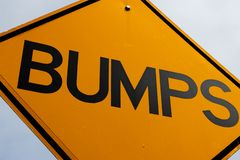 Abstract bumps road sign close up. And a blue sky royalty free stock images