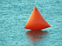 Abstract buoy float. Abstract photo of an orange triangular buoy floating on the sea june 2017 Royalty Free Stock Image